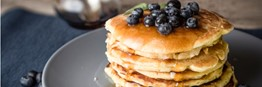 Delicious Vegan Pancakes with Syrup and Blueberries